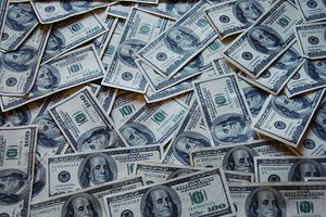 Photograph of an array of one hundred dollar bills