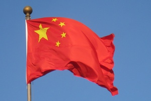 The Chinese flag: a red background with yellow stars