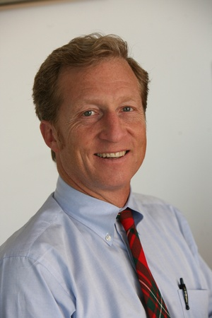 Tom Steyer in light blue shirt with red tie