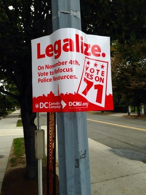 A marijuana legalization poster hangs on a lamp post in Washington, D.C.