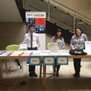From left to right: Ben Green, Kayla Larkin and Renée Walsh setting up Boston Open Data's pop-up table at the main branch of the Boston Public Library.
